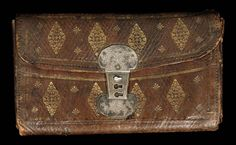 AN OTTOMAN GILT STAMPED LEATHER WALLET WITH THE NAME FISHER MOUNT, TOWER HILL, 1714 sold £4000