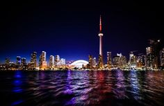 Are you planning a trip to Toronto, Ontario Canada? If so, you have to check out the iconic CN tower in Toronto. Come see the iconic CN tower views of the city of Toronto and save it to your travel board so you can find it later. Toronto Canada, Toronto City, Downtown Toronto, Toronto Shopping, Toronto Hotels, Visit Toronto, Toronto Airport, Torre Cn, Cn Tower
