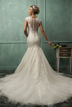 The fabulou and romantic deep scalloped v-neck cap sleeve white tulle floor-length mermaid wedding dress with the fully embroidery bodice and the sheer embroidery button back