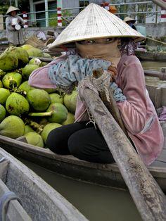 selling coconuts, floating market, Mekong Delta, Vietnam