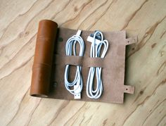 Cordito cord wrap that holds 3 cables and 2 plugs. I WANT THIS.