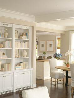Neutral bookcase styling with shades of white. #organizedlifestyle