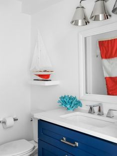 Americana style nautical & coastal uses the colors red blue and white which are great contrast colors. The blue is a darker hue, such as navy. Featured on Completely Coastal. this is a bathroom in HGTV's Dream Home 2021. Coastal Bathroom Decor, Nautical Bathrooms, Coastal Decor, Bathroom Ideas, Hgtv Dream Homes, Blue Vanity, Room Pictures, Rustic White, Blue Walls