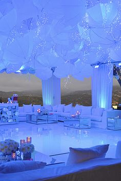 The lighting and umbrellas define this space (instead of umbrella if we cant find them ...maybe we could have the black and white ballons?) but love the lounge and dance floor....