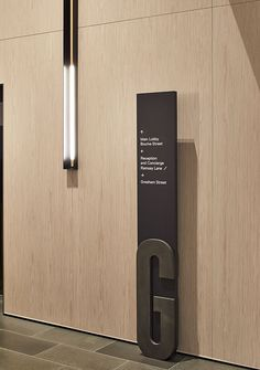 Like charcoal colour against light wood. Lighting and signage very stylish. Hotel Signage, Office Signage, Signage Display, Signage Design, Environmental Graphic Design, Environmental Graphics, Wayfinding Signs, Exterior Signage, Hospital Design