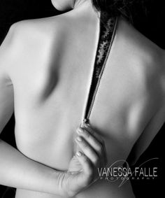 Dramatic black and white portrait depicting a model unzipping her skin. Most of the effects were created with special effects makeup.