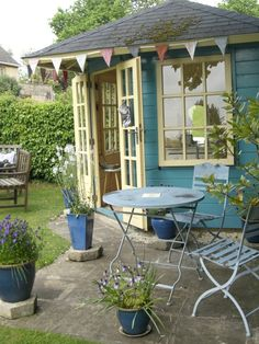 English garden summer studio/occasional shop from Offbeat Home, so wonderful with the french doors - buttery yellow trim & a little patio of it's own.from Offbeat Home, so wonderful with the french doors - buttery yellow trim & a little patio of it's own. Cottage Garden Sheds, Cottage Garden Design, Outdoor Spaces, Outdoor Living, Outdoor Art, Home And Garden Store, Garden Shop, Backyard Studio, She Sheds