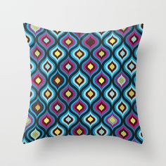 Peacock feather geometrical pillow in blue, pink and black colors. Perfect as a modern addition to your bedroom.