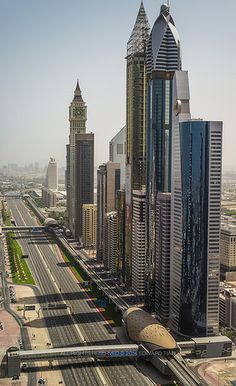Sheikh Zayed Road, #Dubai and the #MetroStation and line on the right. http://www.travelmagma.com/united-arab-emirates/things-to-do-in-dubai/