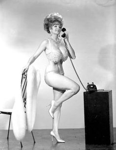 Tempest Storm takes an important phonecall.. A late 60's-era promo photo..
