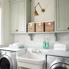 Green Laundry Room Cabinets with Whirlpool Washer and Dryer