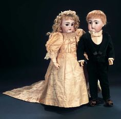 """18"""" (46 cm.) Each has bisque socket head,brown glass sleep eyes,painted lashes,brush-stroked brows,accented nostrils and eye corners,open mouth four porcelain teeth,blonde or light brown mohair wig,composition and wooden ball-jointed body. Condition: generally excellent. Marks: 192 9 (groom) 79 10 Germany H 2 (bride)."""