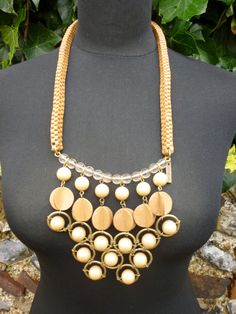 This is a leather roped necklace which would look fabulous on a slinkyb black dress for a bohemian evening extravanganza. for Hire (UK only) £30 including postage. Contact akinulic@aol.com