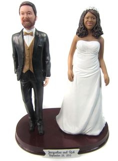 Plus Sized Bride and Groom Cake Topper sculpted to look like the bride and groom.  Lots of fun styles to choose from!