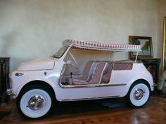 "The ""Jolly de Plage"" or ""Joker of the Beach"" was created by Gianni Agnelli, Fiat chairman and famous Italian playboy, in 1957.  Used as beach cars, estate roundabouts, yacht tenders, and golf carts, the Jolly came in pink, coral, white, pale yellow, and sky blue. They feature wicker seats and the option of a fringed surrey top. Each Fiat Jolly is unique, as many were custom handmade to order creations."