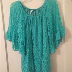 Lacy blouse Turquoise lace blouse with shear lace sleeves! Only wore once! Fits loose and comfortable. The neck is scooped! The body of the blouse has a turquoise lining that is stretchy. It's a large. Tops Blouses