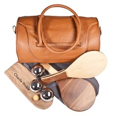 Charlie Noble leather bag. To stash my rosewood and olive wood ping pong racquets of course, and the bocce balls too.
