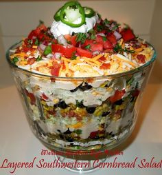 This Layered Southwestern Cornbread Salad makes a spectacular edible centerpiece. It features layers of flavorful vegetables with a spicy ranch dressing. Mexican Food Recipes, Great Recipes, Favorite Recipes, Spicy Ranch Dressing, Melissas Southern Style Kitchen, Tasty, Yummy Food, Snacks, C'est Bon