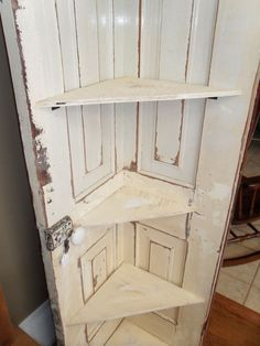 Corner shelf made out of a door. Love. this would be great for craft show booth!