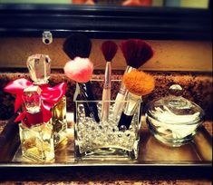 Put my makeup brushes and perfumes on a vintage tray for cute deco.