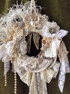 This is a very beautiful made by me shabby chic wreath which I made using vintage crocheted doilies which I found at flea markets. I know