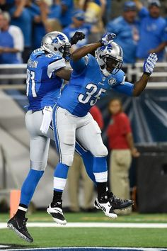 Calvin Johnson and Joique Bell celebrate a first-quarter touchdown, 09/08/2014