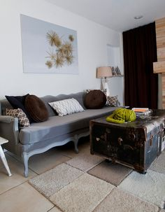 """One pinner said """"We created the area rug out of $ 1.00 carpet samples we found at an upholstery outlet and fused them together with Gorilla Tape on the underside."""""""