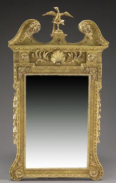 A George II giltwood mirror mid 18th century The rectangular plate surmounted by a swan's neck crest centering a gilt phoenix with berried swags descending at the sides. height 4ft 3in