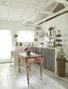 I love this kitchen, but I would need more storage. And Josh would kill me over the girly-ness. Maybe I could have this in my studio cottage (since I'll serve snacks and drinks - I'll need a kitchenette at least)!