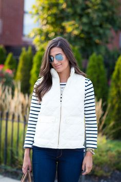 navy striped shirt + ivory quilted vest + skinny jeans