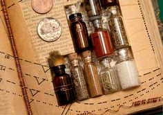 hundreds of little bottles and lots of old books (alchemy theme for my altered book? Mini Bottles, Bottles And Jars, Apothecary Bottles, Glass Vials, Small Bottles, Altered Book Art, Altered Bottles, Handmade Books, Handmade Notebook