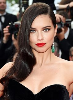 Adriana Lima proves that red carpet glamour and a classic red lip are always on-trend