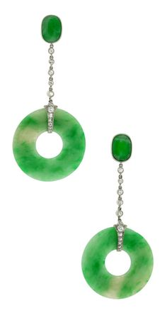 Art Deco Jade Diamond Dangle Earrings. These classic Art Deco earrings feature vivid jade Pi ornamented with sleek diamond-set platinum fittings and chains. The 14k white gold jade-set tops which complete the look beautifully were possibly added latter. Via 1stdibs.