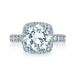 The beloved Tacori Dantela design is more beautiful than ever in this RoyalT collection engagement ring. A 2 carat round center diamond blooms with a cushion-style bloom.