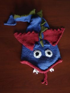 Free knitting pattern for Dragon Hat - Darlene Kitterman designed this stocking hat of a winged dragon that inspired many variations.