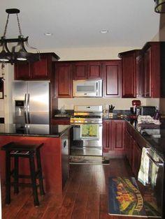 Dark cabinets with stainless steel appliances  Dark Granite