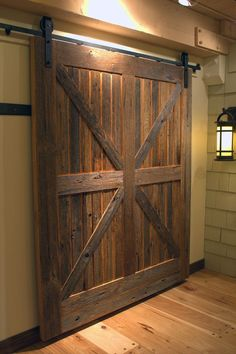 rustic sliding doors | Sliding barn doors are often rustic, embodying the warmth…