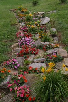 Recycled Rock Garden. This would be great between sidewalk and street!
