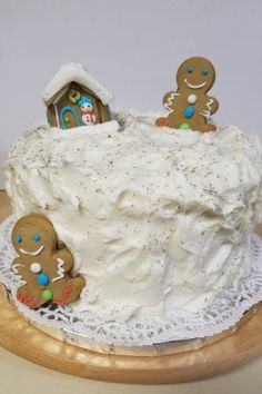 "A super yummy gingerbread cake, decorated with white buttercream ""snow"" and adorable gingerbread men. Holiday cake, yes!"