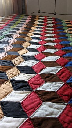 Vintage quilt with hand sewn tumbling block design. M. Ruth flikr