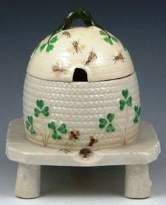 Ireland, An [Irish] Belleek [porcelain] Shamrock honey pot and cover. Marked with black 3rd Mark (1926 to 1946).