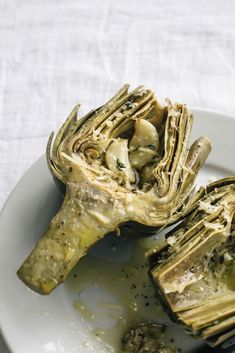 Learn how to roast artichokes with this step-by-step tutorial (with photos!) and grab the recipe for these Roasted Artichokes with Garlic and Parmesan