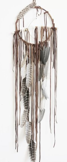 Someday I will get around to making my own...these are so stinkin' cool! #feathers #dreamcathers