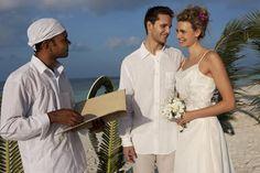 Wedding couple at island resort ceremony - Caroline von Tuempling/Iconica/Getty Images