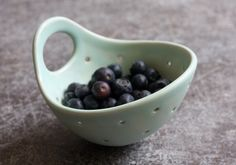 Pottery Berry Bowl with Handle - Small in Seafoam Green - Ceramic Colander by FringeandFettle on Etsy https://www.etsy.com/listing/242269856/pottery-berry-bowl-with-handle-small-in