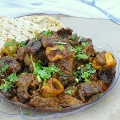 a deep, dark, rich lamb curry packed with flavours from the spices, aromatics, yoghurt and kewra essence.