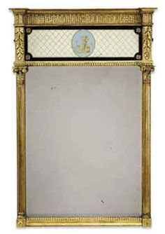A REGENCY GILTWOOD VERRE EGLOMISE PIER MIRROR EARLY 19TH CENTURY