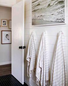 look what happens when you replace traditional towel bars with hooks. ⚓️ Sweet and simple beachy bathroom via 🙌🏻 Kid Bathroom Decor, Bathroom Renos, Bathroom Towels, Hooks In Bathroom, Master Bathroom, White Bathroom, Bathroom Storage, Pool Bathroom, Bathroom Plants