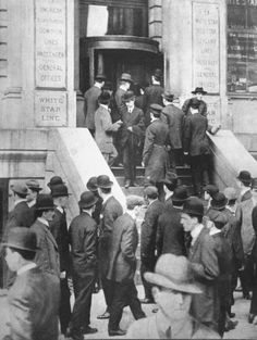 "Anxious callers outside offices of the White Star Line waiting to learn news of survivors of shipwreck of luxury liner ""Titanic"" which sank off Newfoundland after it struck an iceberg on its maiden voyage. New York, NY, US Now the former WSL Office is a Radio Shack."