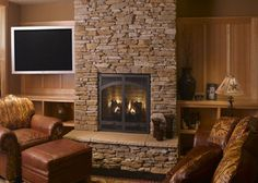 Stone Indoor Fireplaces ancient style corner fireplace stone facing with sconces and